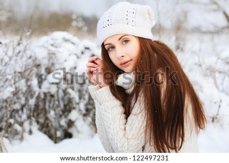 Portrait of attractive young brunette in winter - stock photo