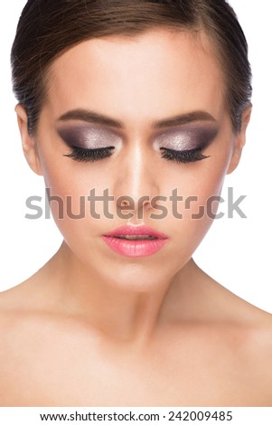 Portrait of attractive young caucasian woman with stylish bright makeup - stock photo