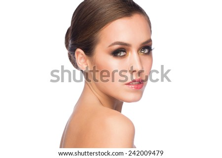 Portrait of attractive young caucasian woman with stylish bright makeup smoky eyes - stock photo