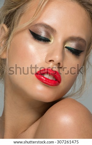 Portrait of attractive young caucasian woman with stylish fancy makeup  - stock photo