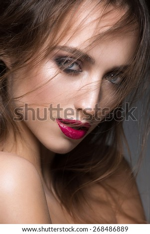 Portrait of attractive young caucasian woman with stylish makeup and fashion hairstyle - stock photo