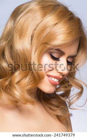 Portrait of attractive young caucasian woman with stylish makeup and hairstyle - stock photo
