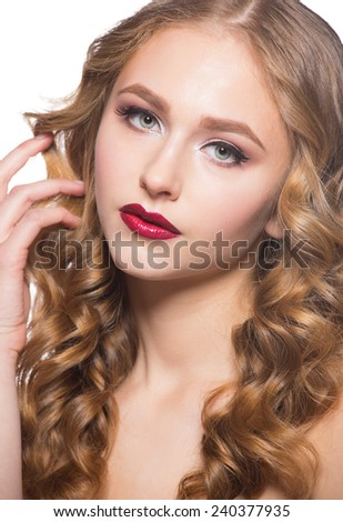 Portrait of attractive young caucasian woman with stylish makeup and wavy hairstyle - stock photo