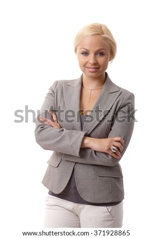 Portrait of attractive young confident businesswoman standing arms crossed. - stock photo