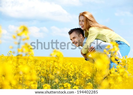 Portrait of attractive young couple in love outdoors. Love and freedom  - stock photo