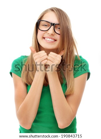 Portrait of attractive young girl laughing at camera with thumbs up. - stock photo
