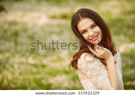 Portrait of attractive young girl on a sunny summer day - stock photo