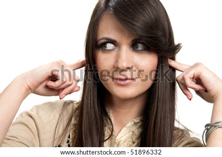 Portrait of attractive young girl with fingers in ear not listening isolated on white - stock photo