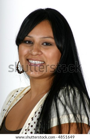 portrait of attractive young Hispanic woman smiling at the camera