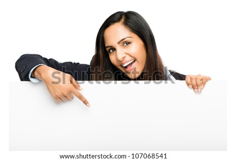 Portrait of attractive young indian woman holding billboard on white background - stock photo