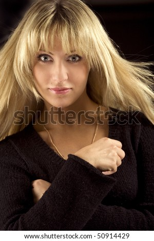 Portrait of attractive young lady in a black sweater - stock photo