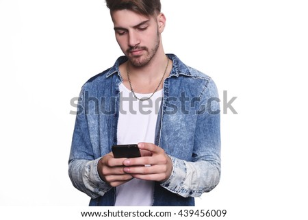 Portrait of attractive young man talking on his phone. Isolated white background.