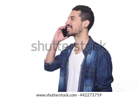 Portrait of attractive young man talking on his phone. Isolated white background. - stock photo