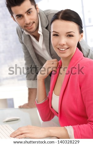 Portrait of attractive young office workers in the office. - stock photo