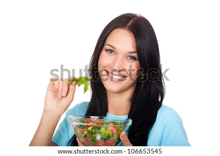 Portrait of attractive young smile woman eating vegetable salad, holding bowl in hand, isolated over white background