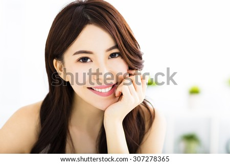 portrait of attractive young smiling woman - stock photo