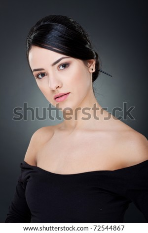 Portrait of attractive young smiling woman with beautiful face - stock photo