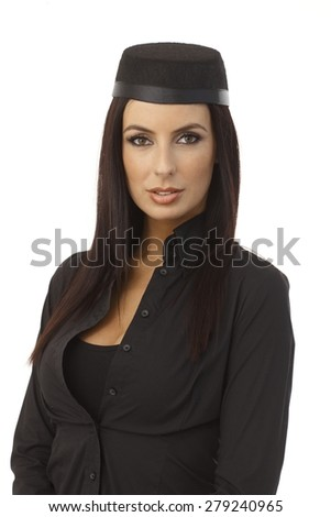 Portrait of attractive young stewardess looking at camera. - stock photo