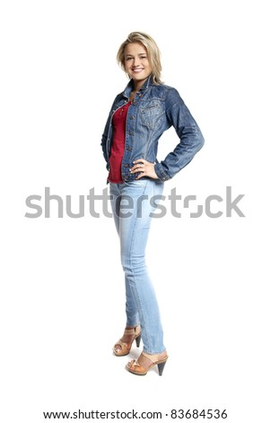 Portrait of attractive young woman in a blue jeans looking at camera. - stock photo