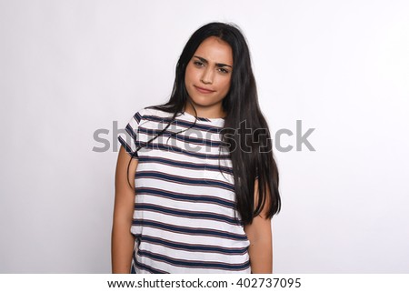 Portrait of attractive young woman in a studio. Isolated white background. - stock photo