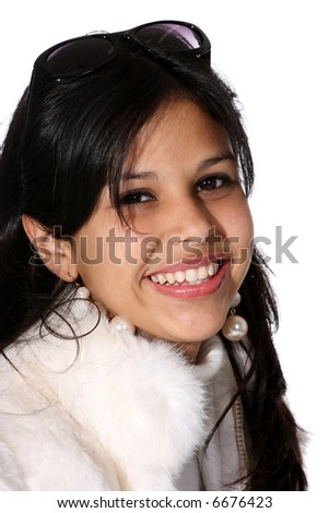 Portrait of attractive young woman in a white fur coat