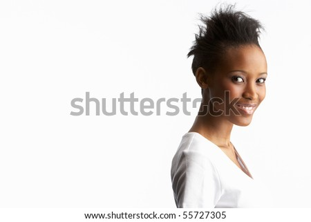 Portrait Of Attractive Young Woman In Studio - stock photo