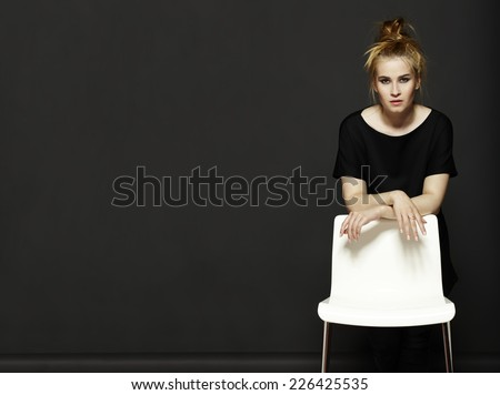 Portrait of attractive young woman on black background. - stock photo