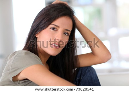 Portrait of attractive young woman relaxing at home