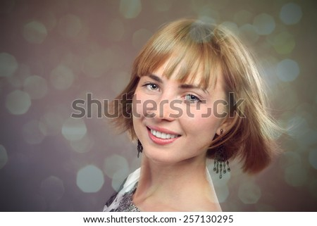 portrait of attractive young woman smiling in cheerful mood - stock photo