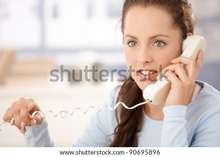 Portrait of attractive young woman talking on phone.? - stock photo
