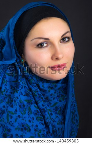 Portrait of attractive young woman with a shawl
