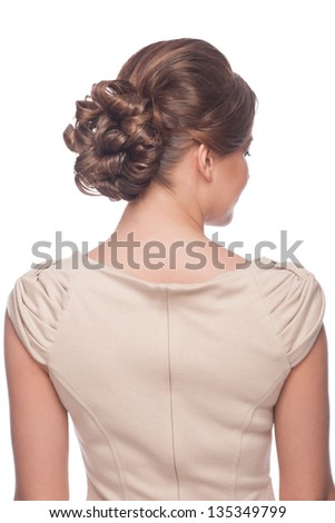 Portrait of attractive young woman with beautiful hairstyle. Isolated on white background - stock photo