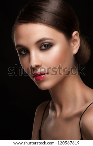 Portrait of attractive young woman with bright makeup
