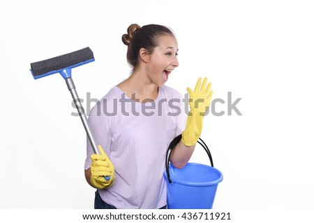 Portrait of attractive young woman with cleaning gloves and bucket. Isolated white background. - stock photo