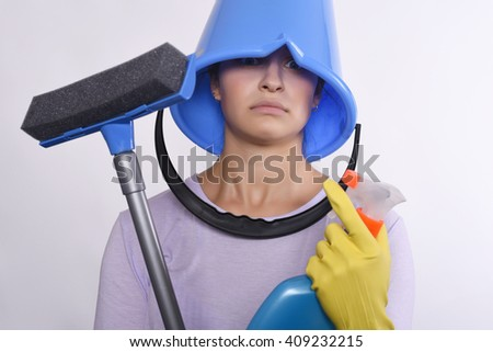 Portrait of attractive young woman with cleaning products, gloves and bucket. Isolated white background. - stock photo