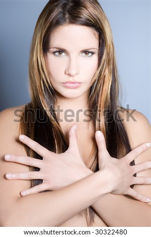 Portrait of attractive young woman with long hair - stock photo