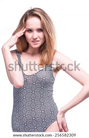 Portrait of attractive young woman with migraine. Isolated over white background - stock photo