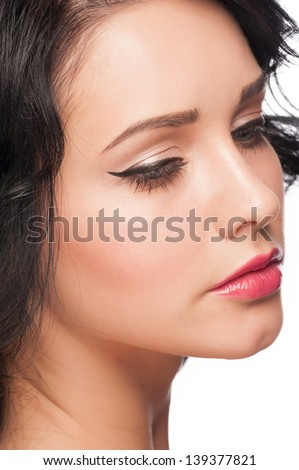 Portrait of attractive young woman with stylish bright makeup