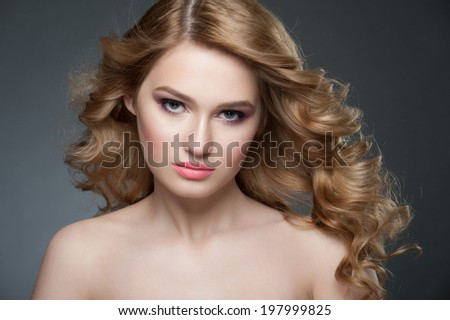 Portrait of attractive young woman with stylish makeup and beautiful hairstyle