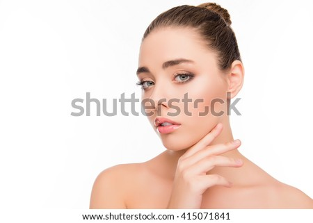 Portrait of attrective beautiful woman touching her chin - stock photo