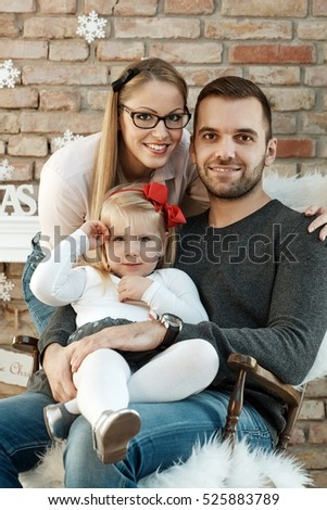 Portrait of authentic family smiling happy at christmas time.