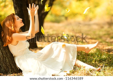 portrait of autumn happy woman with leaves - stock photo