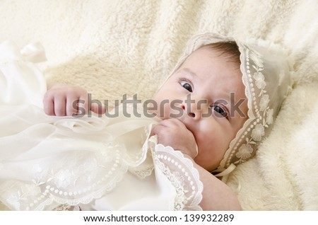 Portrait of baby biting hands - stock photo