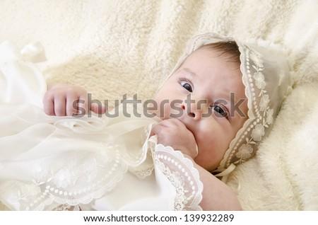 Portrait of baby biting hands - stock photo