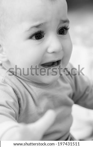 Portrait of baby boy crying - stock photo