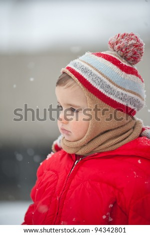 Portrait of baby boy in the snow.
