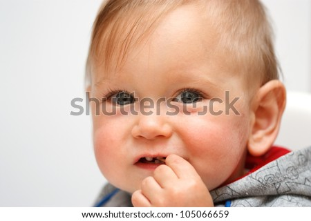 Portrait of Baby boy with toothpick in mouth