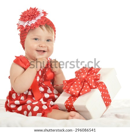 Portrait of baby girl in cute  dress  with gift - stock photo