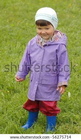 Portrait of baby girl in raincoat - stock photo