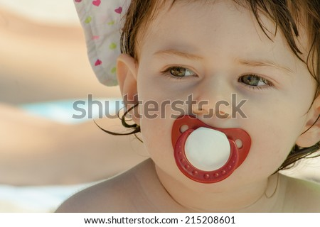 Portrait of baby girl on beach